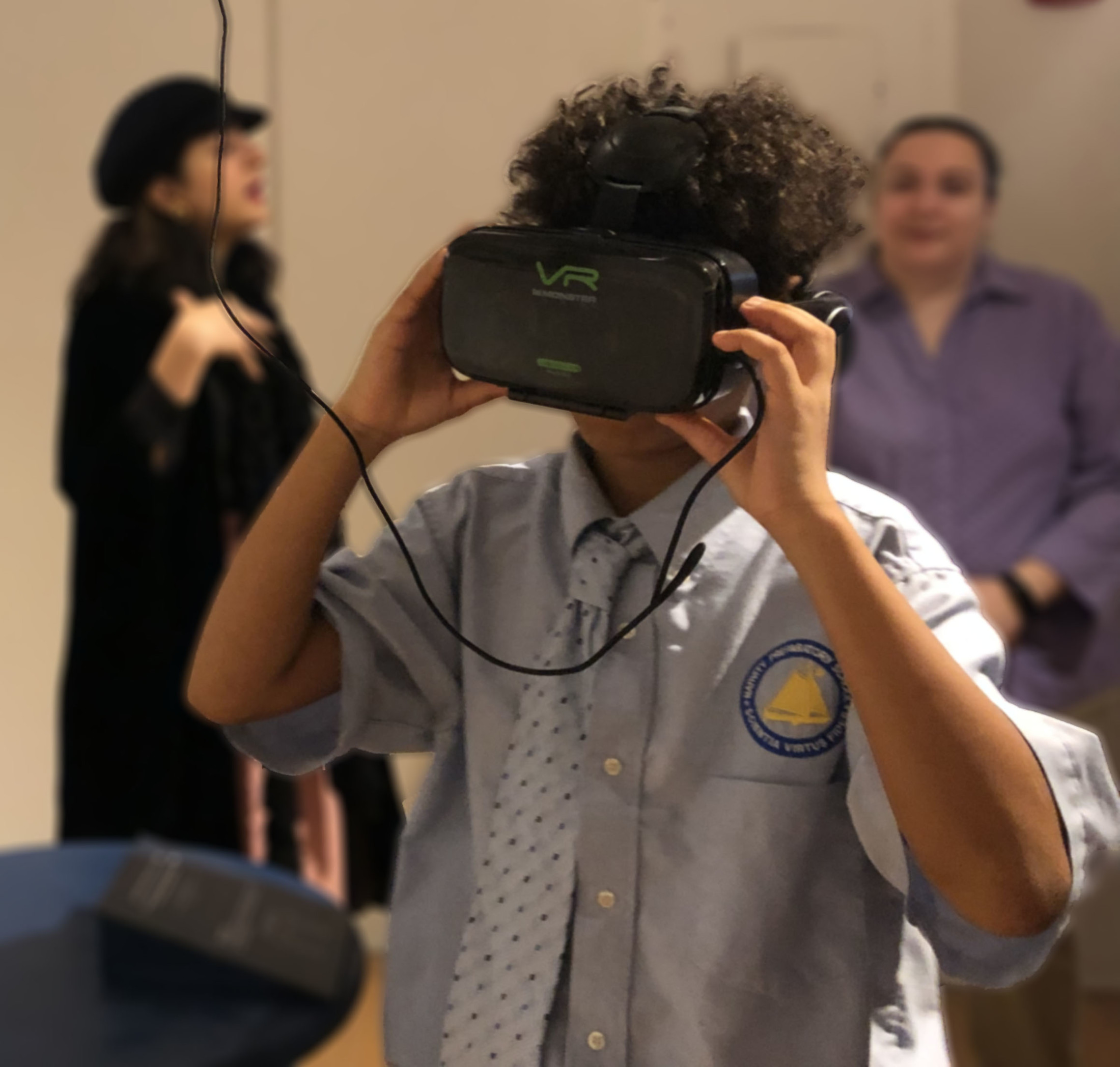 Student engages in Virtual Reality Tour at the Black Spaces Matter Exhibit in New Bedford, MA.